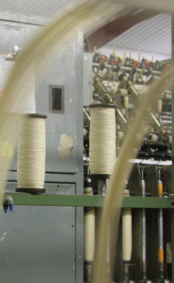 View of bobbins through skeins being wound
